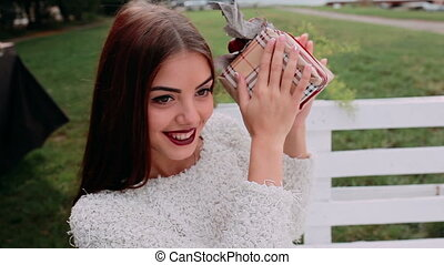 Beautiful girl holding gift