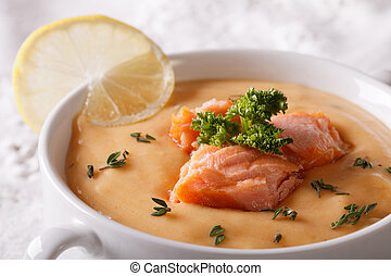 Salmon soup with lemon macro in a bowl horizontal - Salmon...