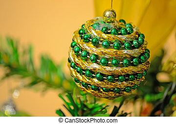 green and gold Christmas ball