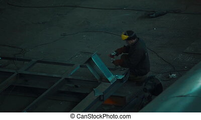 Worker welding in a factory - Worker welding in a industrial...