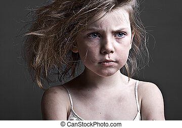 Messy Child against a Grey Background - Powerful Shot of a...