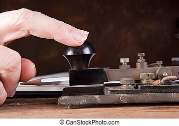 Morse code - Fingers tapping morse code on an antique...