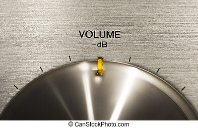 volume push button on a hi-fi - close up of a volume push...
