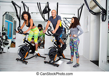 group at the gym - group at an exercise class using spinning...