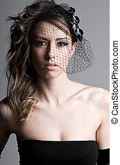 Stunning Fashion Model in Veil against Grey Background