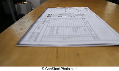 manufacturing drawings with shallow depth of field in