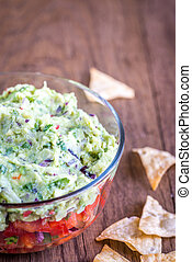Bowl of guacamole with salsa