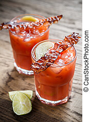 Two glasses of Bloody Mary with bacon rashers - Two glasses...