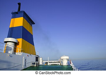 Boat bow in colorful yellow and blue colors  turquoise sea
