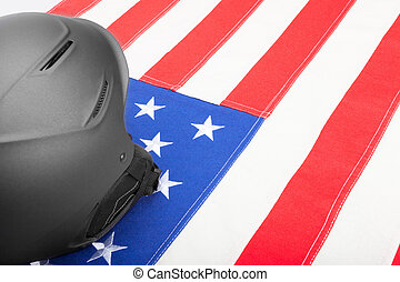 Black helmet over US flag as symbol of active life style -...