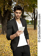 Businessman texting on mobilephone