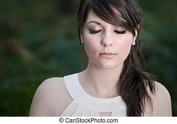 Beautiful Teenage Girl with Eyes Shut - Shot of a Beautiful...