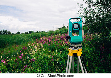 blue surveying equipment total station on a background of...