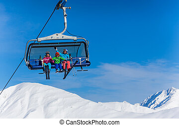 Skiers on ski lift - Ski, skiing - family skiers on ski lift