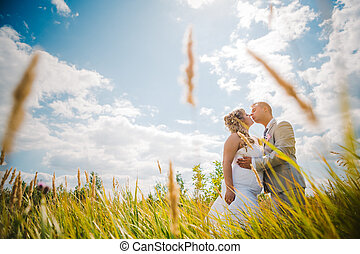 Wedding beautiful young couple kissing on the background of...