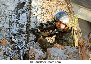 Sniper with a machine gun in an ambush