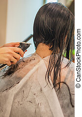 Hair Cut - Young woman, 25 years, getting hair cut, rear...