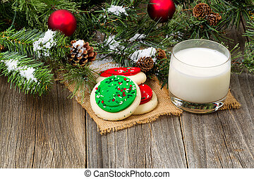 Colorful sweet sugar cookies and milk for the holiday season...