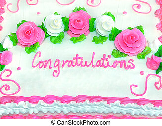 Congratulations in iced writing decorates frosted white cake...