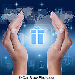 Hand showing gift box icon symbol on screen business concept...