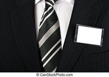 Blank nametag on a well dressed man - Empty business...