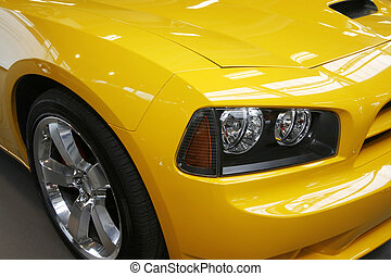 Yellow muscle car - Close-up of a new modern muscle car
