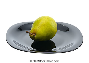 Pear on a black platte, isolated - Pear on a black platte on...