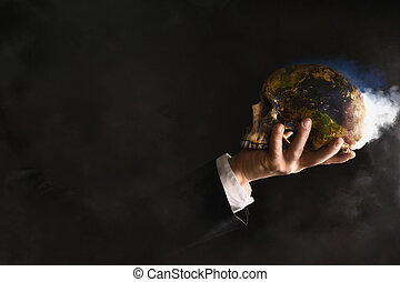Businessman holding a burning globe while they mutated into...
