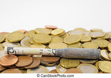 Money and Weapons Concept Bullet and Money on a White...