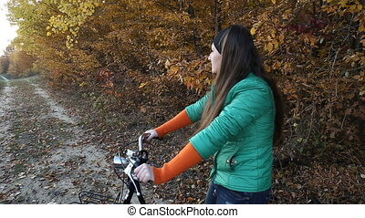 Girl with a bicycle - Girl with bicycle on nature