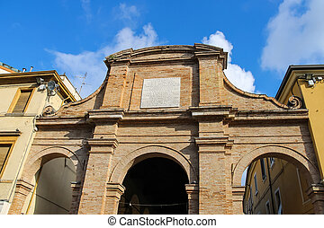Ancient wall with arch on Cavour square in Rimini, Italy