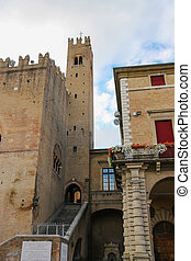 Ancient building with tower near Rimini City Hall on Cavour...