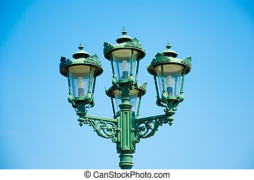 The street lamp with blue shy in background