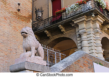 Ancient building with old stone statue on Cavour square in...