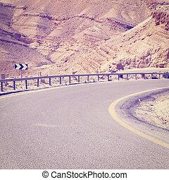 Road in Desert - Winding Asphalt Road in the Negev Desert in...