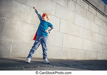 Dreamlike - Little boy dressed as superman outdoors
