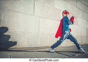 Sport - Little boy with boxing gloves outdoors