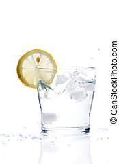 Glass of lemonade - glass of liquid with lemon isolated over...
