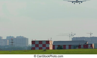 Airplane landing at the airport - Panning shot of an...