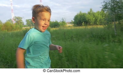 Little Boy Running on Country Road - Steadicam shot of a...