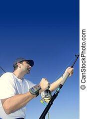 Angler fisherman trolling rod and reel fishing - Angler...