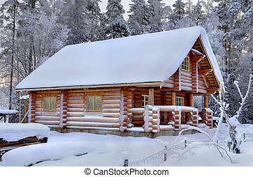 New wooden Russian sauna in a snowy winter forest, sunny...