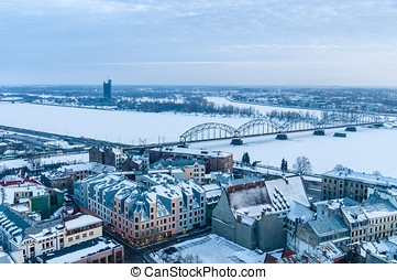 Railway bridge across winter-time Daugava river, Riga,...