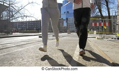 Young sportive couple having run outdoor - Slow motion...