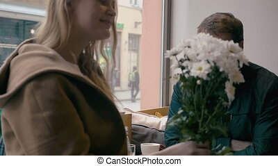 Loving couple looking at each other in cafe - Slow motion...