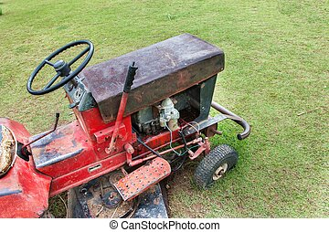 Old lawn mower for periodically garden upkeep