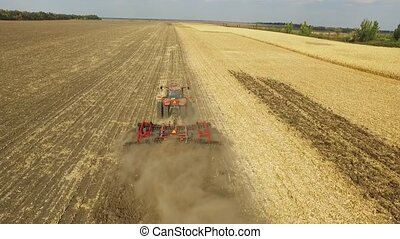tractor preparing land for sowing aerial shot, field corn -...