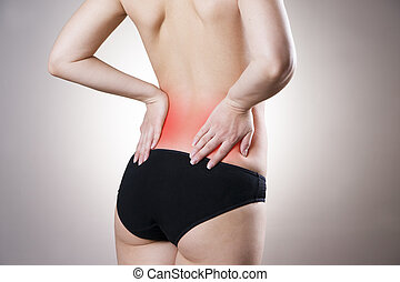 Pain in lower back of women on gray background Caring for...