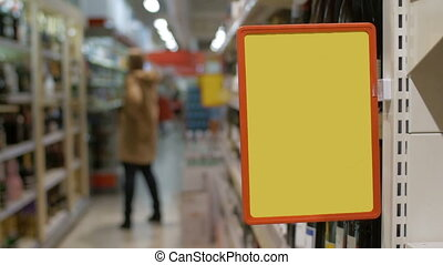 Empty advertising board in the supermarket - Slow motion...