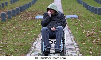 Disabled veteran in wheelchair at cemetery